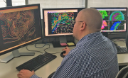 PHOTO - Weather Prediction Center Meteorologist Andrew Orrison uses weather model data